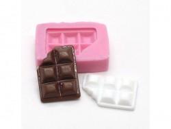 Kleine Silikonform für ein abgebissenes Schokoladenstück