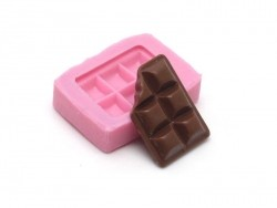 Small, nibbled on piece of chocolate silicone mould
