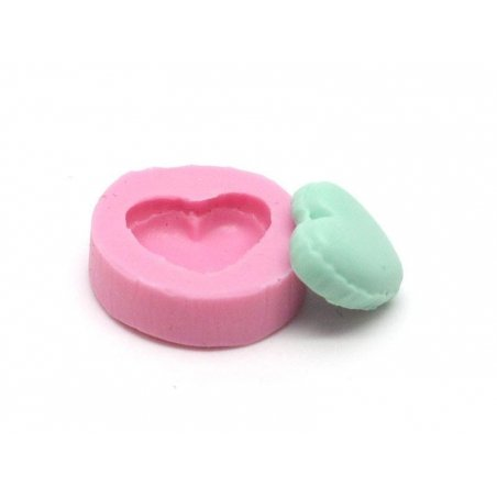 Small, heart-shaped half of a macaroon silicone mould