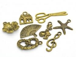 1 breloque clé de Sol - couleur bronze