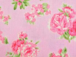 Gemusterter Stoffrest - Rosen auf rosafarbenem Hintergrund