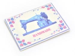 """Bügelbild / Aufkleber - mit einer Nähmaschine und der Aufschrift """"Handmade"""""""