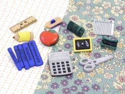Boutons en plastique - Trousse d'écolier