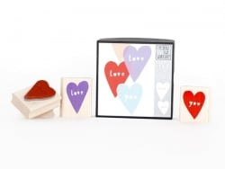 "Heart stamp with the word ""love"" + heart stamp with the word ""you"""