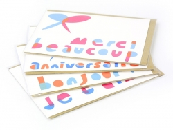 "1 card bearing the words ""Merci beaucoup"" (Thank you very much) + envelope"
