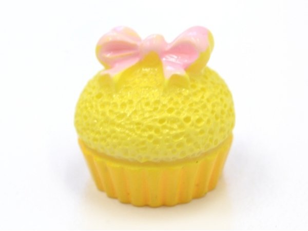 Yellow cupcake cabochon with a small bow