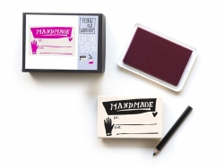 "Gift tag stamp with the word ""handmade"" + pink ink pad + black pencil"