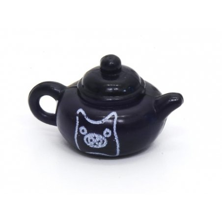 1 Teapot with a Pig on it