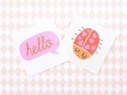 """2 Tatouages """"hello"""" et coccinelle - rouge et rose"""