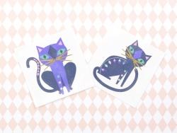 2 Katzentattoos - schwarz, gold, grün und lila