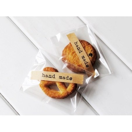"24 stickers made of kraft paper, bearing the word ""Handmade"""