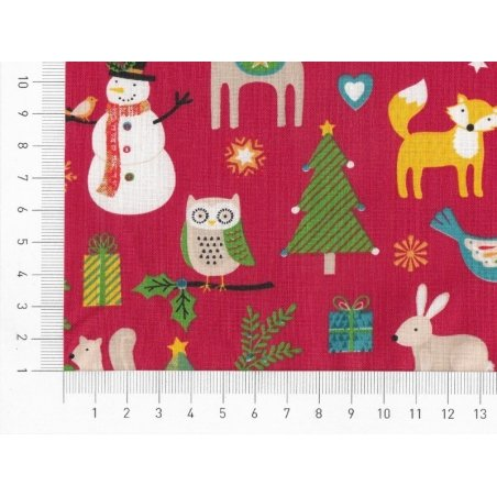 Patterned remnant - Christmas patterns and animals on a red background