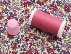 1 dé à coudre rose en plastique