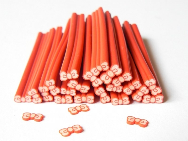Acheter Cane noeud rouge- modelage et pâte fimo - 0,99€ en ligne sur La Petite Epicerie - Loisirs créatifs