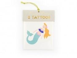 2 tattoos - a mermaid and shells