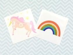 2 tattoos - a unicorn and a rainbow