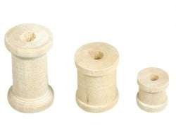 Assortment of 24 light-coloured wooden bobbins