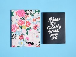 2 notebooks - black and flowers