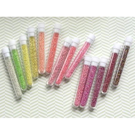Tube de 350 perles transparentes à inclusions colorées - rose framboise