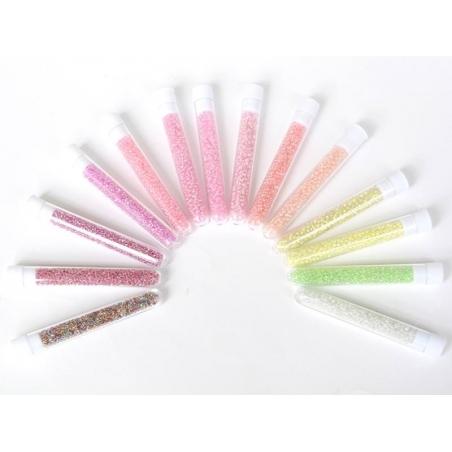 Tube de 350 perles transparentes à inclusions colorées - rose bonbon transparent