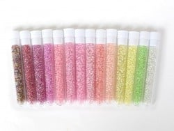 Tube of 350 transparent beads with colourful inclusions - apple green