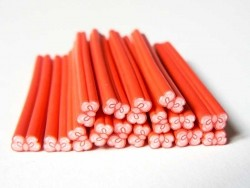 Schleifencane - rot mit Punkten
