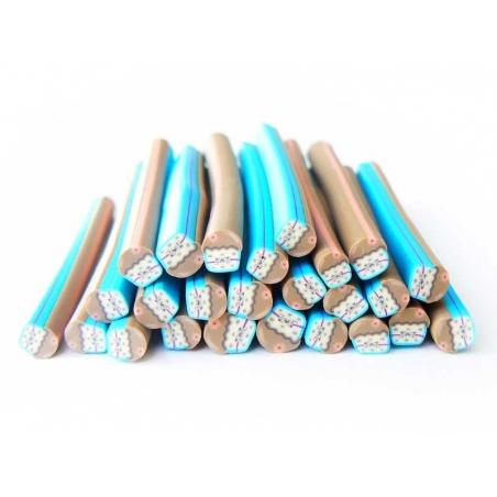 Acheter Cane cupcake bleu et noeud en fimo - 0,49€ en ligne sur La Petite Epicerie - Loisirs créatifs