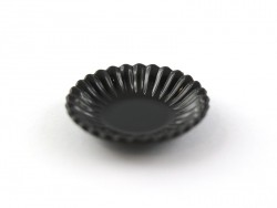 Black plastic plate with a fluted edge