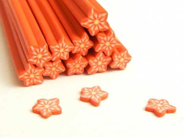 Acheter Cane étoile rouge rayures- en pâte fimo - à trancher - 0,99€ en ligne sur La Petite Epicerie - Loisirs créatifs
