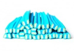 Acheter Cane papillon bleu et pois vert en pâte polymère - 0,99€ en ligne sur La Petite Epicerie - Loisirs créatifs