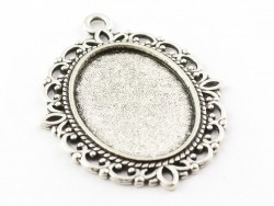 1 oval silver-coloured pendant with a cabochon base - 39 mm