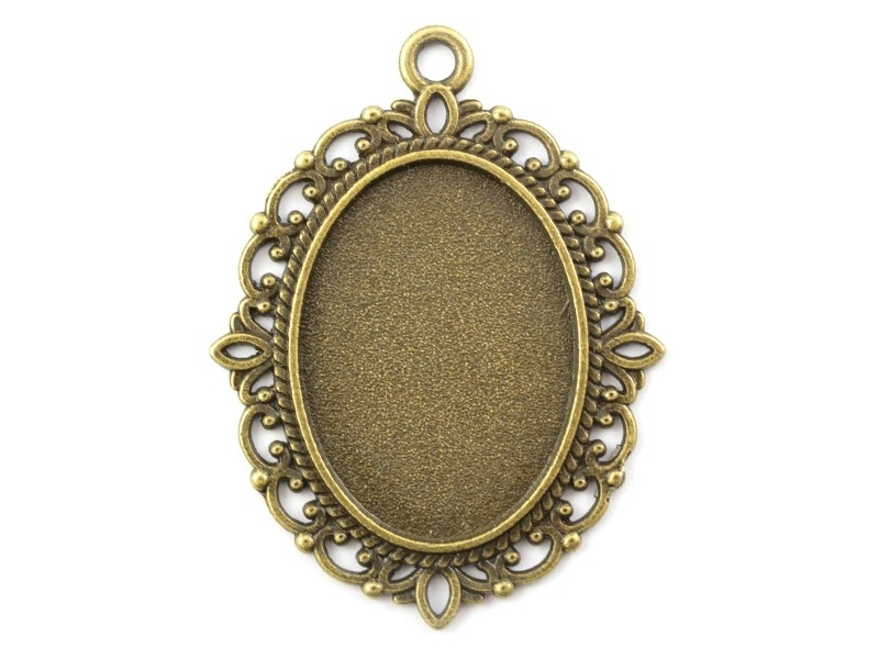 1 oval bronze-coloured pendant with a cabochon base and ornaments - 40 mm