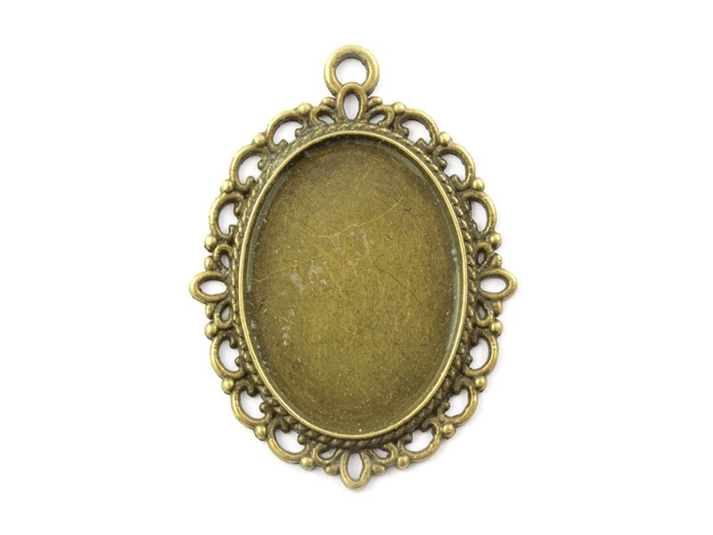1 oval bronze-coloured pendant with a cabochon base and ornaments - 39 mm