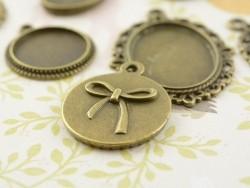 1 breloque support pour cabochon bronze rond à motif noeud - 18 mm