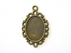 1 oval bronze-coloured pendant with a cabochon base and ornaments - 31 mm