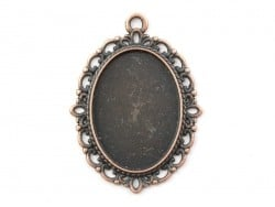 1 oval copper-coloured pendant with a cabochon base and ornaments - 39 mm