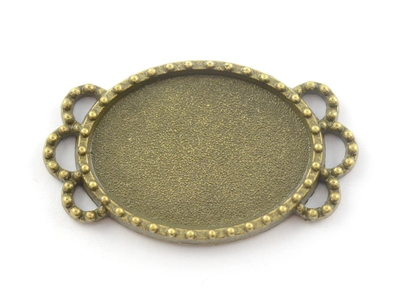 1 oval, bronze-coloured cabochon setting with a fancy edge - 25 mm