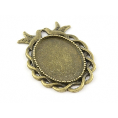 1 oval, bronze-coloured cabochon setting with a fancy edge and birds - 36 mm