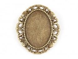 1 oval, bronze-coloured brooch blank with a cabochon setting and a fancy edge - 34 mm