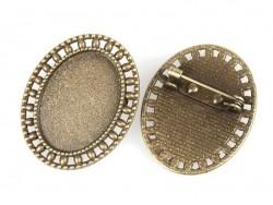 1 ovaler, bronzefarbener Broschenrohling mit Cabochonfassung und verziertem Rand - 33 mm