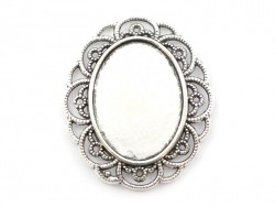 1 oval, silver-coloured domed blank with a cabochon setting and a fancy edge - 40 mm