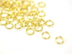 100 gold-coloured double jump rings - 7 mm
