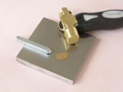 Small metal stamping block