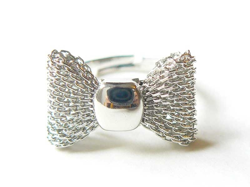 Silver-coloured, cute small ring with a bow