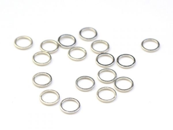 1 small, round, closed jump ring, 8 mm - light silver-coloured