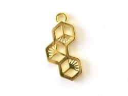 Gold-coloured hexagon charm