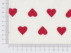 Tissu imprimé blanc à coeurs rouges