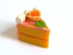 1 köstliches Kuchenstück - Orangenglasur