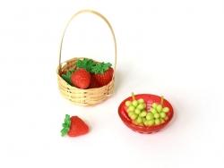 Passoire miniature en plastique rouge
