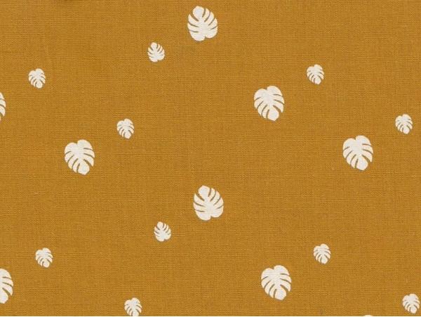 Acheter Tissu motif monstera - moutarde - 1,50€ en ligne sur La Petite Epicerie - 100% Loisirs créatifs